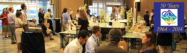 A group of conference attendees gather around high tables and an appetizer buffet at the 2012 reception