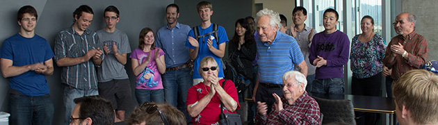 Students and faculty gather around Nico Bloembergen in honor of his 95th birthday