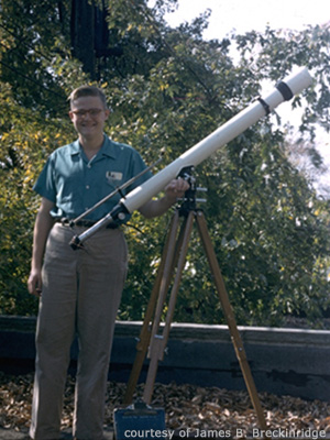 Jim Breckinridge poses on a rooftop with his telescope in 1955