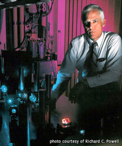 Richard C. Powell with Laser